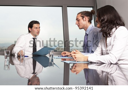 three businesspeople at business meeting in a nice office