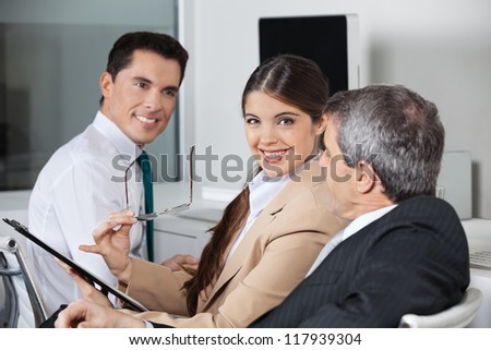 Three businesspeople having a business meeting in the office - stock photo