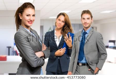 Three businesspeople welcoming you  - stock photo