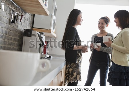 Three businesswomen on the coffee break in the office - stock photo