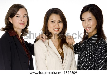 Three businesswomen standing together as a small business team
