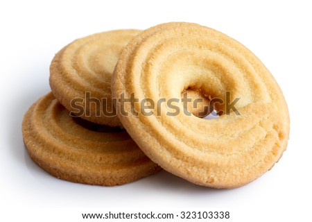 Three butter ring biscuits isolated on white in perspective.