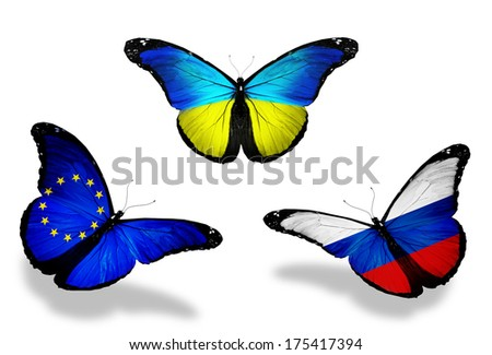 Three butterflies with flags on wings as symbol of relations Russia, European Union and Ukraine - stock photo
