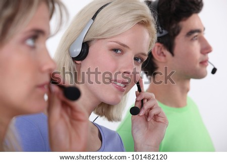 Three call-center workers - stock photo