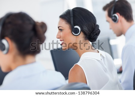 Three call centre employees working in line - stock photo