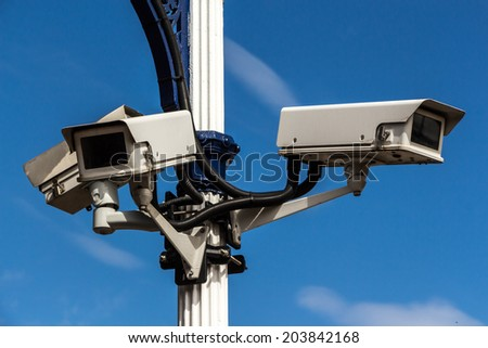 three cameras monitoring the area - stock photo