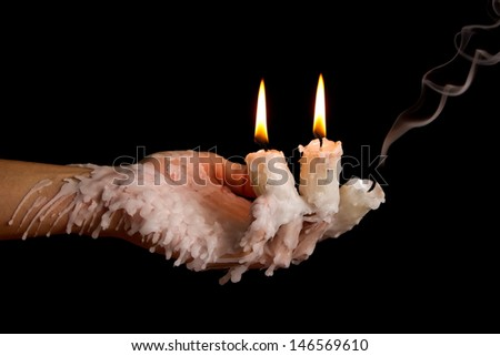 Three candle sticks on fingers burning with wax flow dead - stock photo