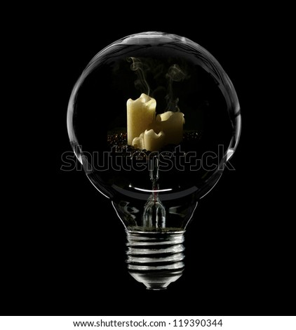 Three candles inside of an old glass incandescent lightbulb. - stock photo
