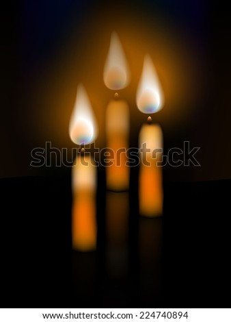 Three candles on a dark background with reflection