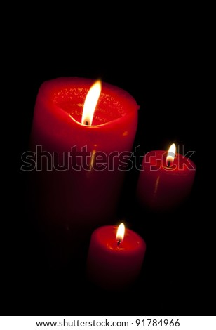 Three candles on black - stock photo