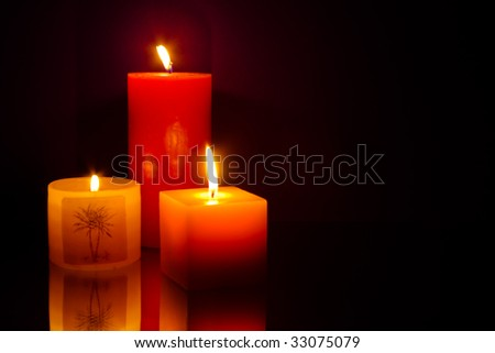 Three candles on blue background