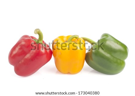 three capsicums isolated on white background  - stock photo