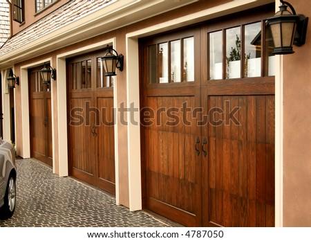 Three Car Garage on Fancy Home - stock photo