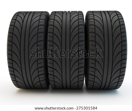 three car tires stand in a row