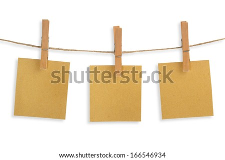 three cards of recycled paper hanging on a clothesline - stock photo