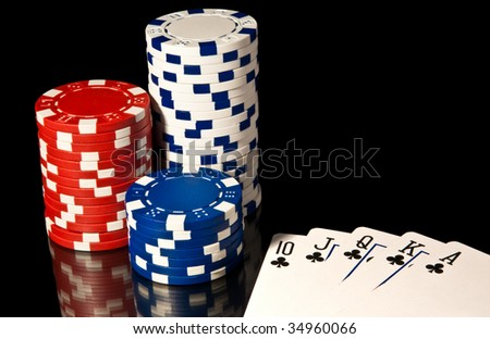 Three casino chip towers and cards - stock photo