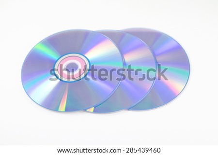 Three CD or DVD on white background - stock photo