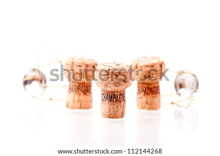 Three Champagne corks close up on white - stock photo