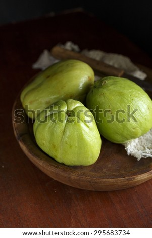 Three Chayotes Chayotes on a wooden board,  - stock photo