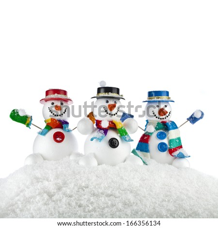 Three Cheerful snowmans in a striped scarfs, mittens and cylindder hat isolated on white background  - stock photo