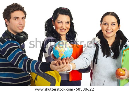 Three cheerful students standing with their hands together and holding a globe in center isolated on white background - stock photo