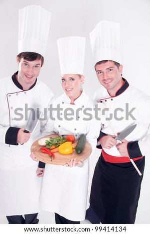 three chefs isolated on white - stock photo