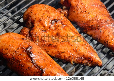 Three Chicken Breasts on the Grill
