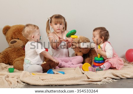 Three children playing educational games