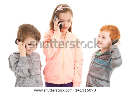 Three children talking on mobile phone. Isolated on white.