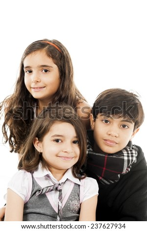 three children together and smiling . - stock photo