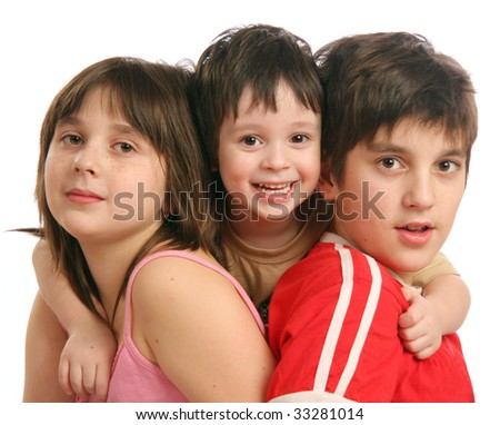 Three children - two brothers and sister - stock photo