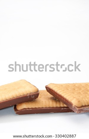 Three chocolate biscuits on a white background.