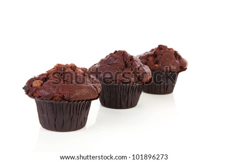 Three chocolate cupcakes isolated on white background