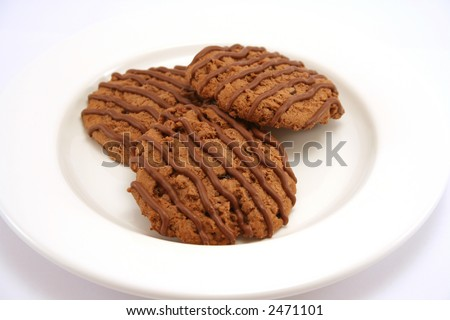 Three chocolate fudge cookies on a white plate - stock photo