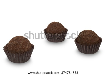 Three chocolate truffle sweets isolated on white background