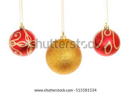 Three Christmas baubles isolated against white