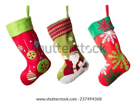 Three Christmas stockings isolated on white background - stock photo