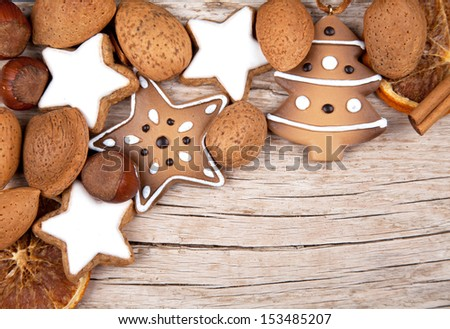 Three cinnamon stars with other christmas decoration