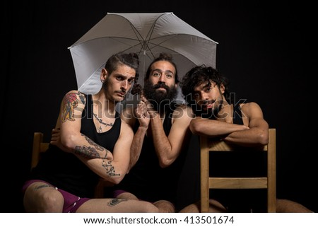 Three circus artists and friends having fun after their performance - stock photo