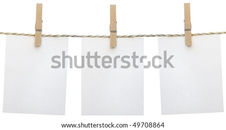 Three clean sheet of paper on clothespin isolated on white background