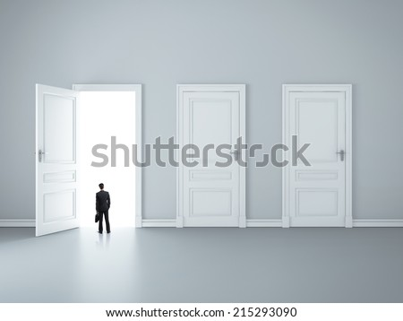 three closed doors and one opened by businessman - stock photo