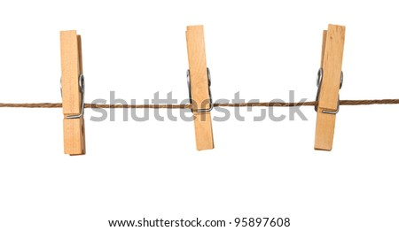 three clothespins on rope - stock photo