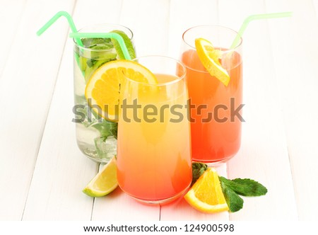Three cocktails on white background - stock photo