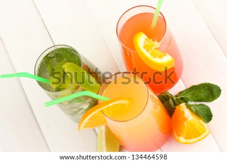 Three cocktails on white background - stock photo