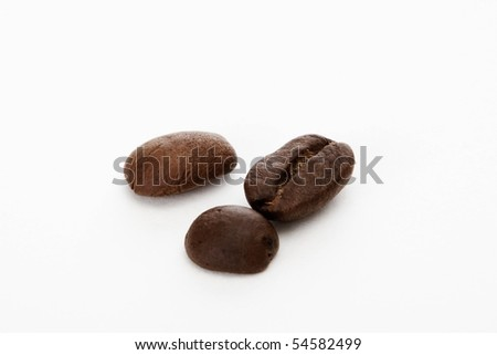 three coffee beans isolated on white background