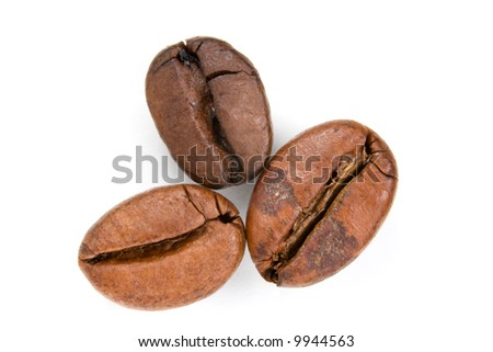 Three coffee beans isolated over white - stock photo