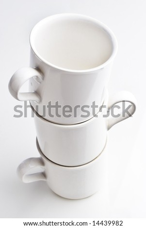 Three coffee cups stacked on top of each other.