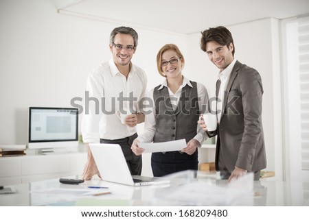 three colleagues take a break at office - stock photo