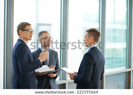Three colleagues talking in office