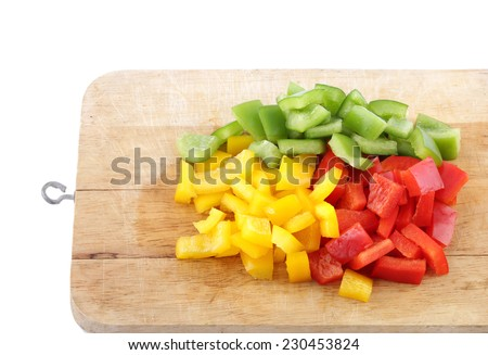 Three-color bell pepper, chopped - stock photo